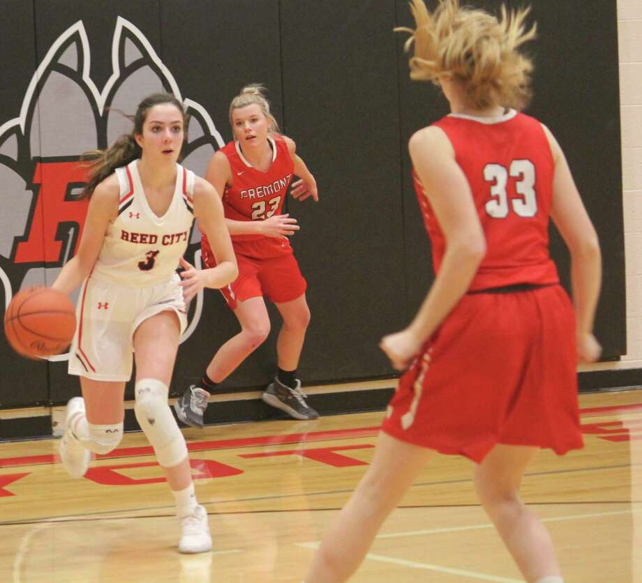 Reed City's Demi Lodholtz (3), pictured here during the basketball season, also plays volleyball and runs track for the Coyotes. (Pioneer file photo)
