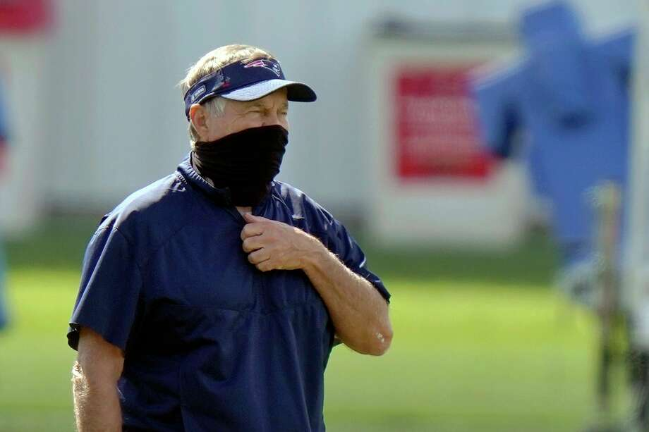 New England Patriots head coach Bill Belichick watches his team practice during an NFL football training camp, Wednesday, Aug. 26, 2020, in Foxborough, Mass. (AP Photo/Steven Senne, Pool) / Copyright 2020 The Associated Press. All rights reserved.