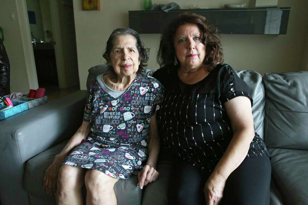 Rose Munoz, furloughed from her job as a banquet server at the Marriott San Antonio Hill Country Resort and Spa, takes care of her mother, Josephine Alexander, 89, at home. Munoz's job at Marriott will be eliminated Oct. 30. The hotel industry has been ravaged by the coronavirus pandemic as conventions have been canceled and travelers have put off recreational trips.