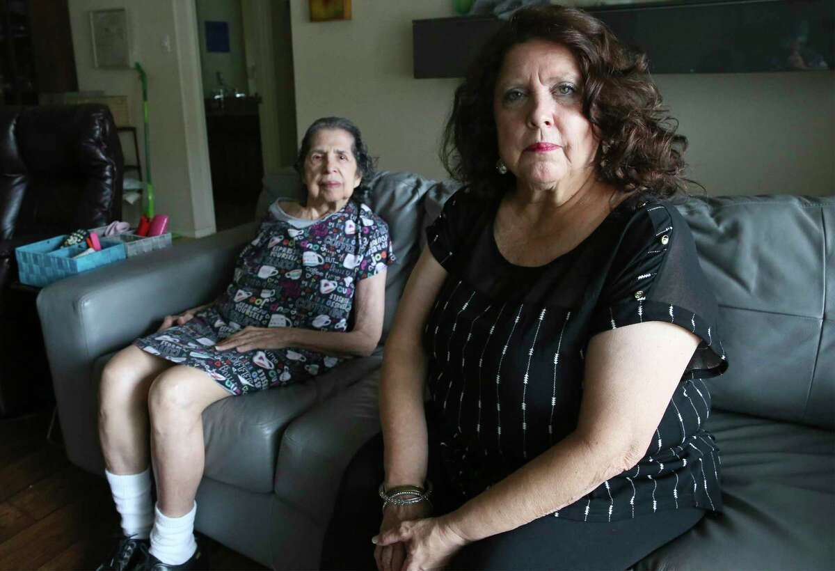 Rose Munoz, furloughed from her job as a banquet server at the Marriott San Antonio Hill Country Resort and Spa, takes care of her mother, Josephine Alexander, 89, at home. Munoz is one of 462 workers at the resort whose jobs will be eliminated Oct. 30.