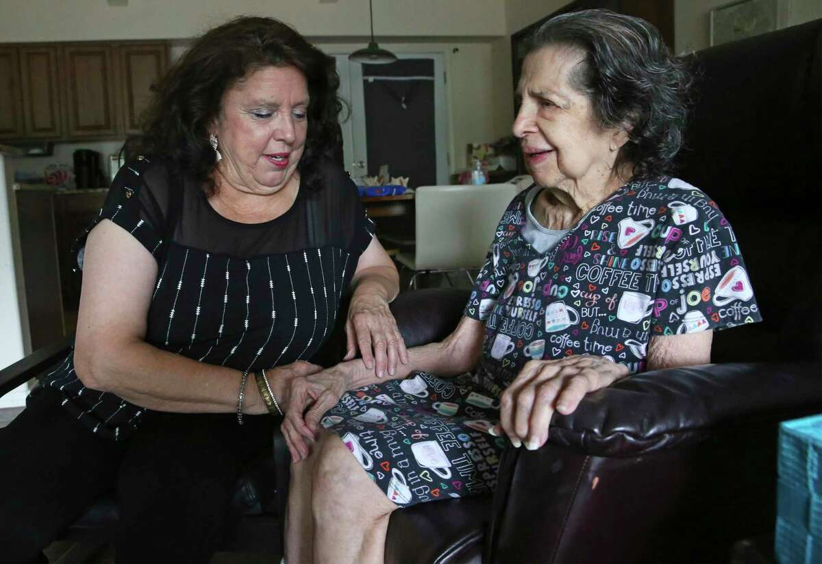 Rose Munoz, left, will lose her job as a banquet server at the Marriott San Antonio Hill Country Resort and Spa on Oct. 30. She has been on furlough since March, when the coronavirus pandemic began causing a sharp downtown in hotel business. Munoz takes care of her mother, Josephine Alexander, 89, at home.