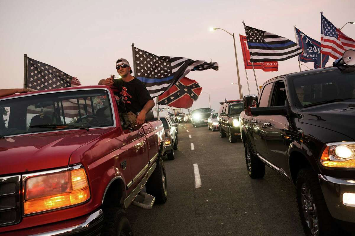 Hundreds gather for the Trump 2020 Cruise Rally as drivers head toward downtown in Portland, Ore., on Saturday, Aug. 29, 2020. A man affiliated with a right-wing group was shot and killed on Saturday after supporters of Trump clashed with protesters. (Mason Trinca/The New York Times)