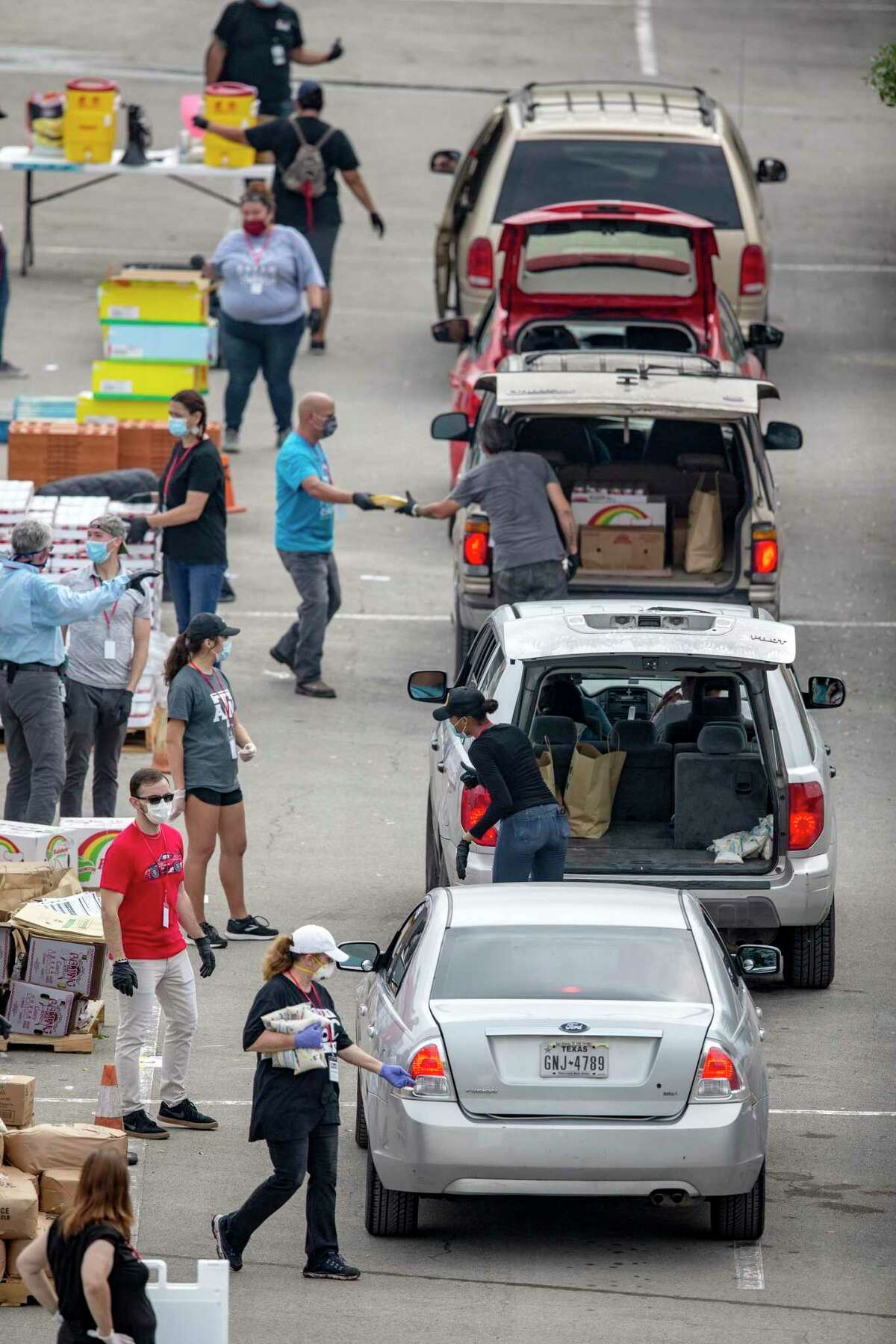 Volunteers distribute food Tuesday, April 7, 2020, in the Toyota Field parking lot for people needing assistance from the Food Bank. Demand for food aid has skyrocketed since the the start of the COVID-19 coronavirus pandemic.