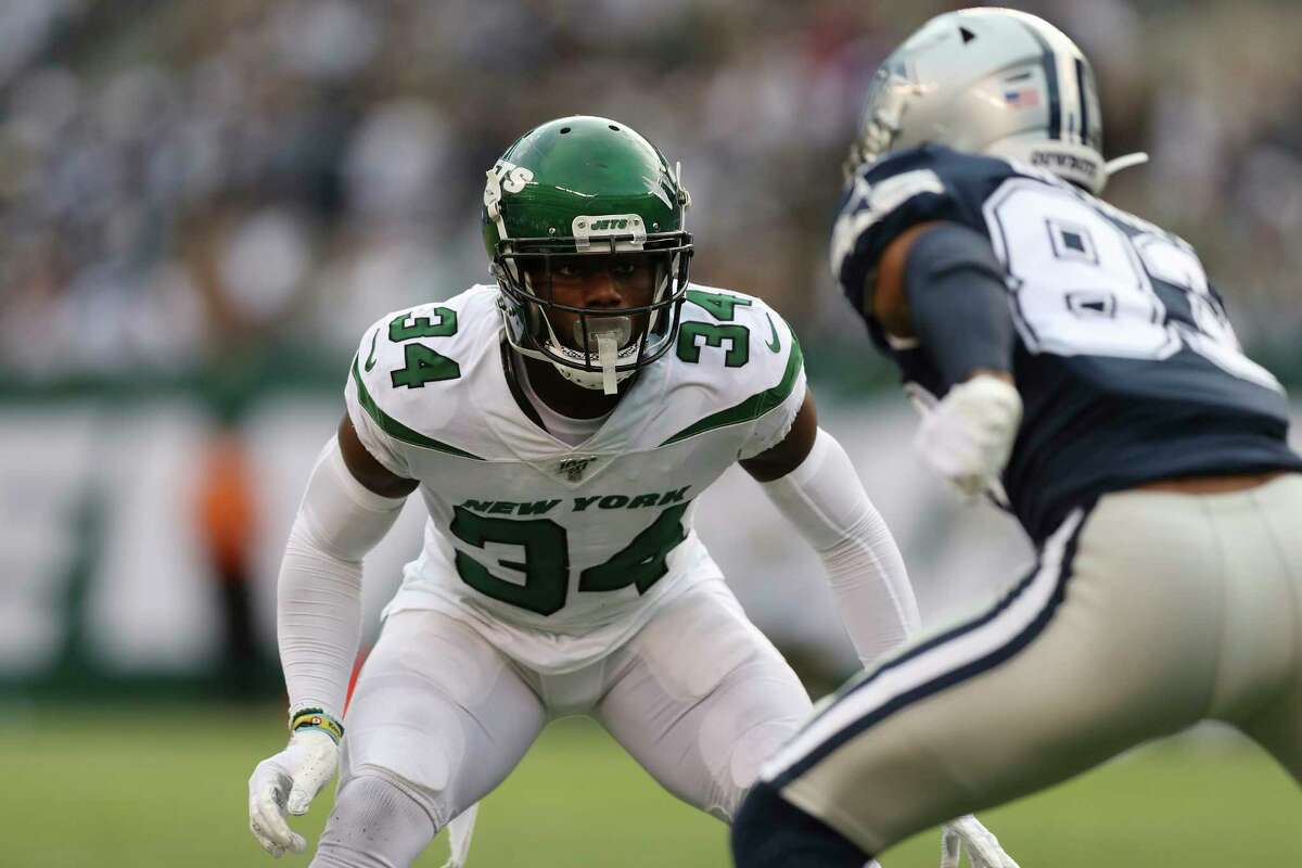 FILE - New York Jets cornerback Brian Poole (34) covers Dallas Cowboys wide receiver Ventell Bryant (83) during the first half of an NFL football game, Sunday, Oct. 13, 2019, in East Rutherford, N.J. Poole was severely dehydrated, worsened by what he said was an undisclosed underlying medical condition. He ended up needing to go to the hospital to be monitored a few hours a€?