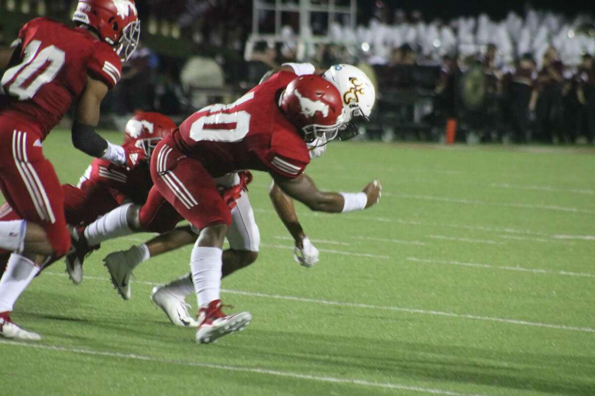 A group of North Shore players bring down a Deer Park ballcarrier last season. Dave Campbell's Texas Football Magazine has the Mustangs ranked No. 1 in the state. Atascocita, which eliminated the Deer from the playoffs last fall, is ranked No. 10.