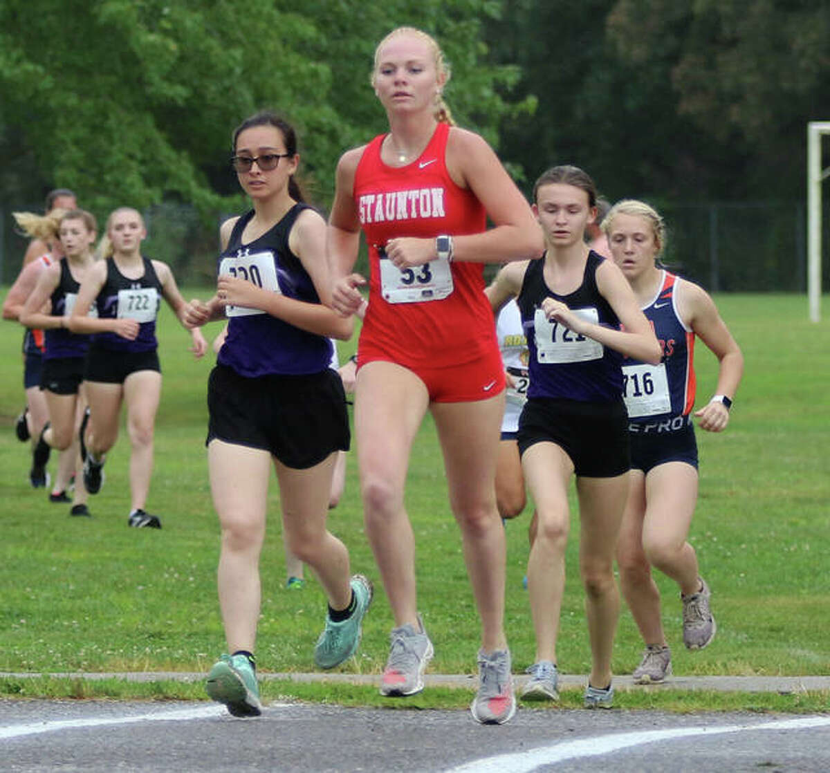 Staunton's Dana Jarden leads a pair of Litchfield runners in the first mile of the Carlinville Early Meet on Tuesday at Loveless Park. Jarden finished fifth in the race.