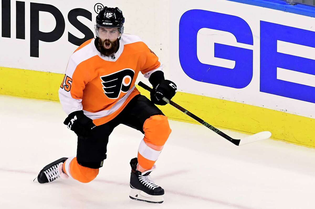 Philadelphia Flyers defenceman Matt Niskanen (15) celebrates after scoring during the third period of an NHL Stanley Cup Eastern Conference playoff hockey game against the New York Islanders, in Toronto, Tuesday, Sept. 1, 2020. (Frank Gunn/The Canadian Press via AP)