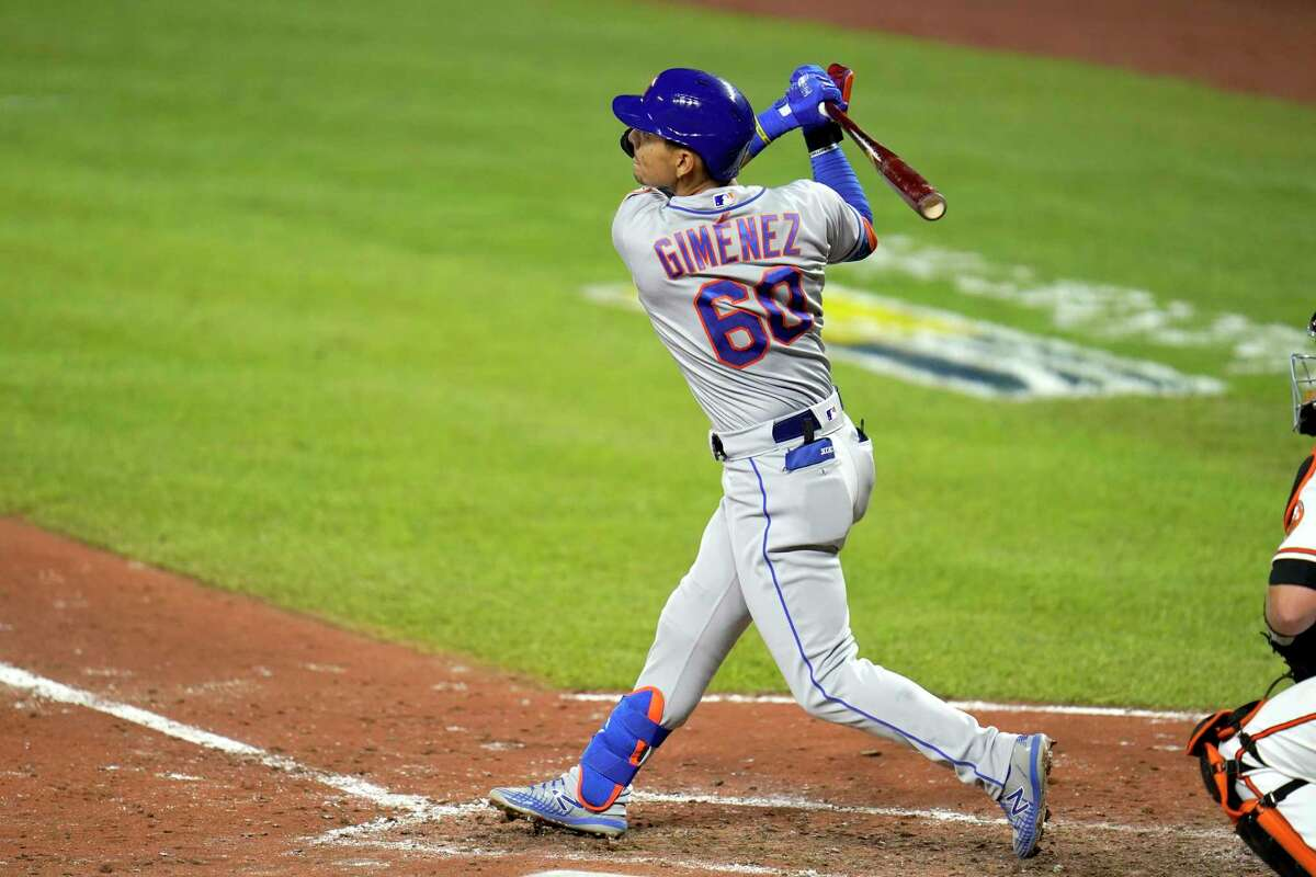 New York Mets' Andres Gimenez follows through on a two-run home run off Baltimore Orioles relief pitcher Tom Eshelman during the sixth inning of a baseball game, Tuesday, Sept. 1, 2020, in Baltimore. Mets' Luis Guillorme scored on the home run. (AP Photo/Julio Cortez)