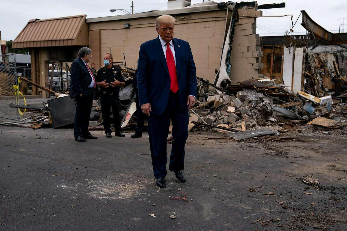 President Donald Trump meets with business owners near the remains of Rode's Camera Shop in Kenosha, Wis., Sept. 1, 2020. (Anna Moneymaker/The New York Times)