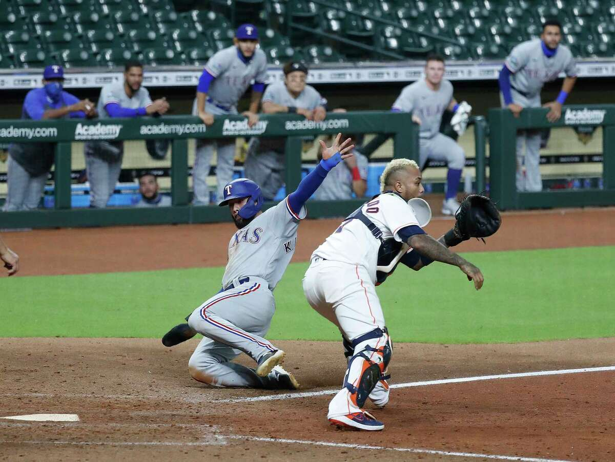 Texas Rangers Isiah Kiner-Falefa (9) scores a run on a throwing error by Houston Astros catcher Martin Maldonado (15) during the tenth inning of an MLB baseball game at Minute Maid Park, Tuesday, September 1, 2020, in Houston.