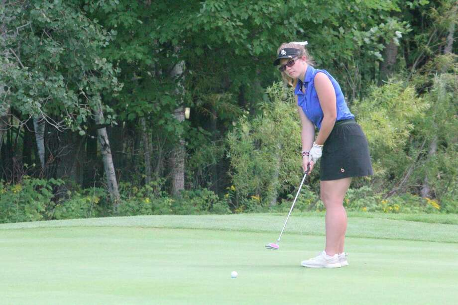 Big Rapids' Emily Mathewson putts on the green at The Pines Golf Course in Canadian Lakes earlier this season. (Pioneer photo/John Raffel)