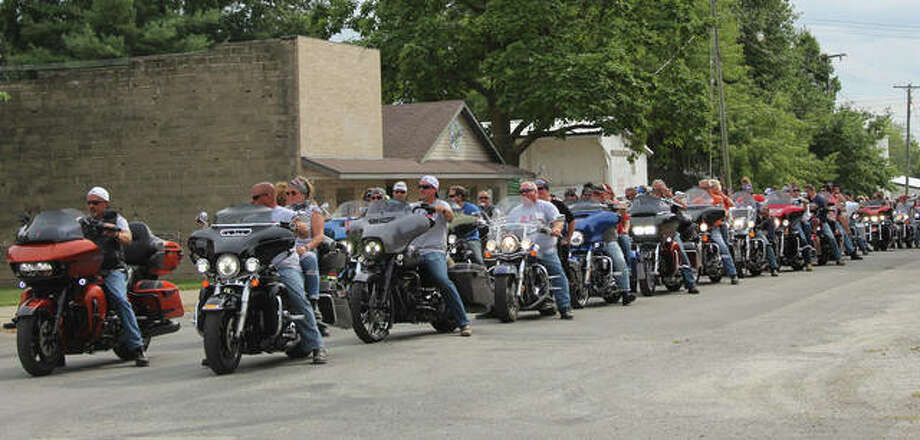 Riders on more than 100 motorcycles prepare to head out for a charitable event known as the Red (Remember Everyone Deployed) Ride. Photo: Photo Provided