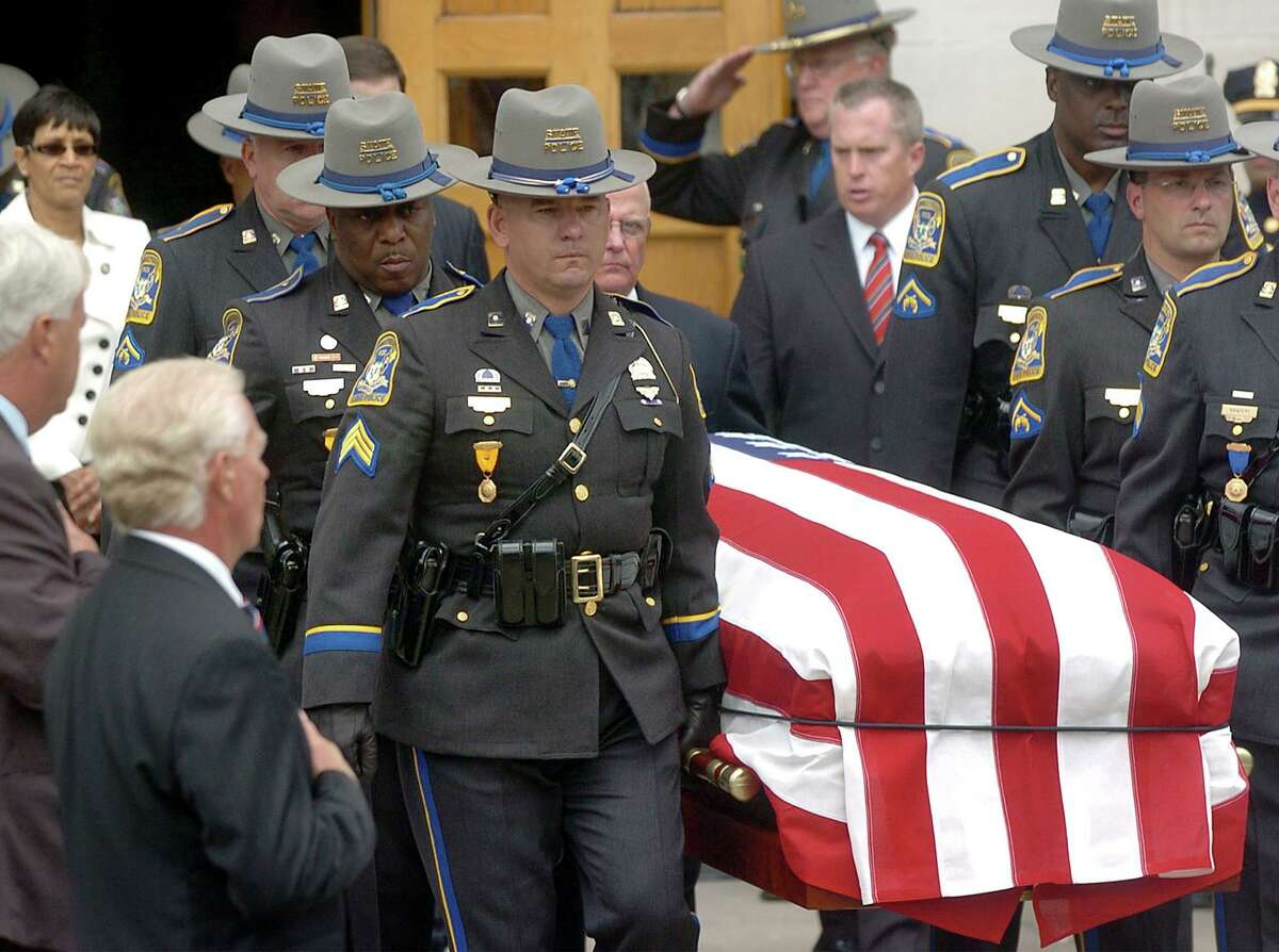 File photo of Connecticut State Police carrying the casket of Trooper Kenneth Hall during his funeral in Hartford, Conn., on Friday, Sept. 10, 2010. He was killed in the line of duty on Sept. 2, 2010.