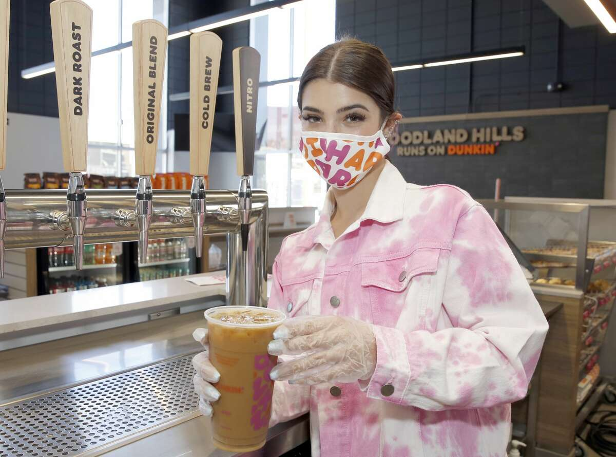 Dunkin' Launches 'The Charli' Drink with Charli D'Amelio on August 31, 2020 in Woodland Hills, California. In an overall banner year professionally, Charli has gone from recording dance videos in her bedroom - the first ones appeared in TikTok in May 2019 - to voicing a character in the animated film,