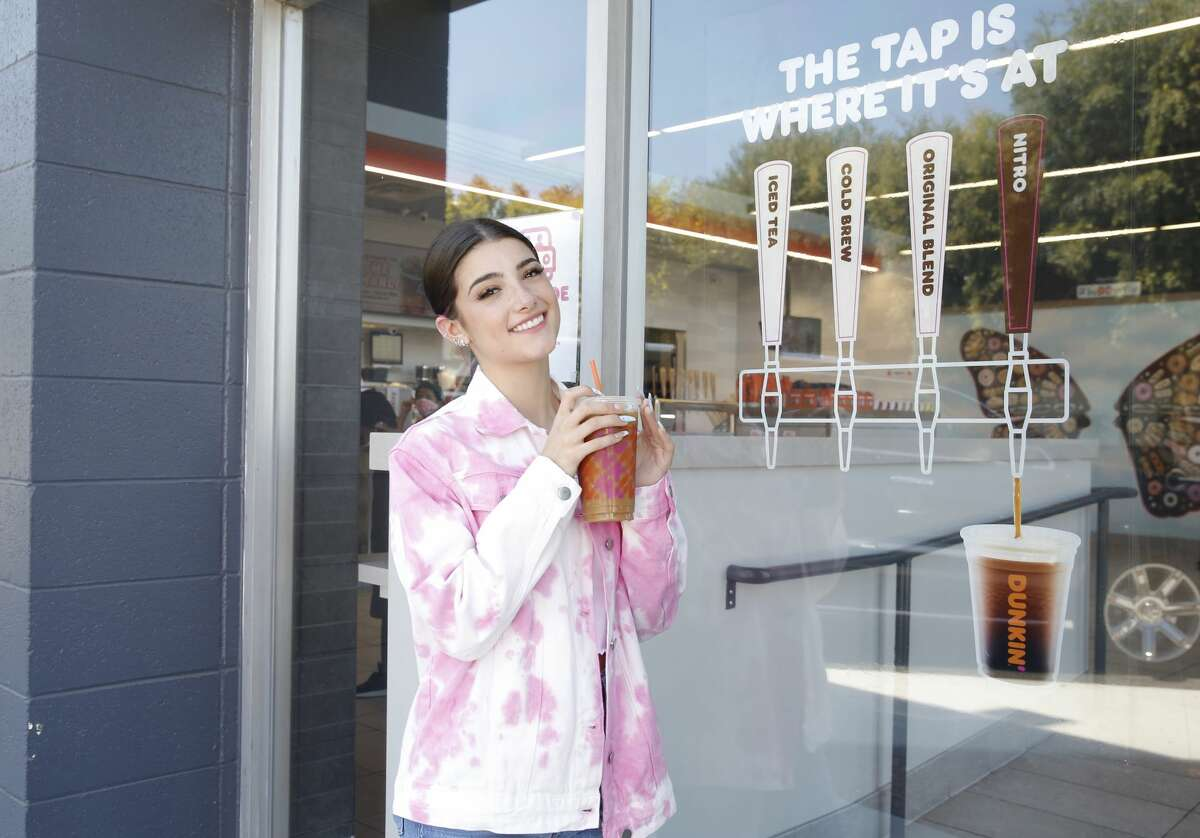 Dunkin' Launches 'The Charli' Drink with Charli D'Amelio on August 31, 2020 in Woodland Hills, California.  The other Tik-Tok star recognized by the Guinness World Records is Zach King, a magician on the app, who has broken the record of the most followed male on Tik-Tok with 41.5 million fans at the time of publication. As of September 28, King 49.9 million followers. Some of D'Amelio's more recent accomplishments include a business partnership with Dunkin' and a new deal with video app Triller, a competitor of Tik-Tok.