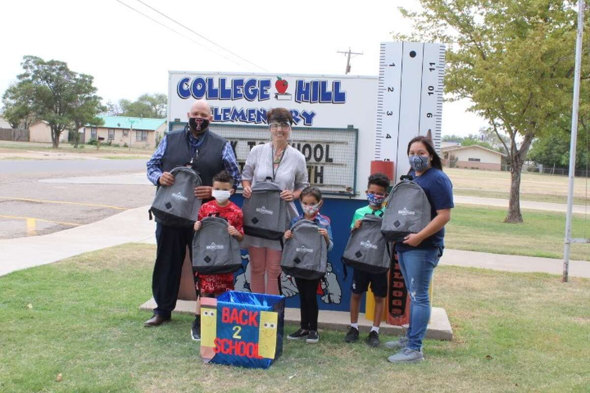 Yvette Arellano, manager of Easy Stop Storage in Plainview, (far right) stops by College Hill Elementary on Monday to donate school supplies collected during Easy Stop Storage's drive. Pictured (from left to right): Maurice Harvey, assistant principal, Josiyas Hernandez, Aracelli Hernandez, Principal Lori Glenn, Carter Jackson and Yvette Arellano.