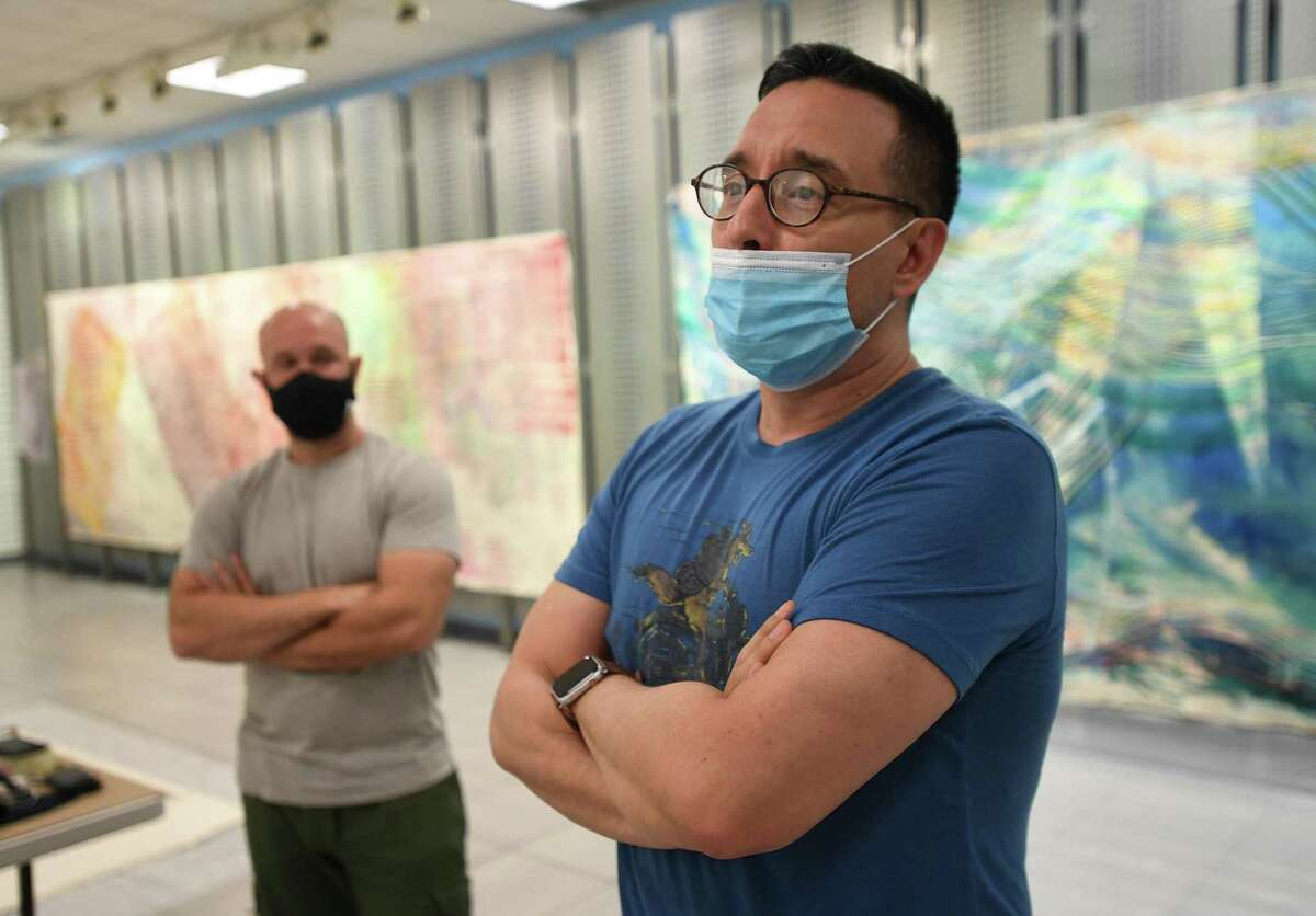Ben Quesnel, left, and Fernando Luis Alvarez check out the work of Westport artist Alyse Rosner at the Sprouting Spaces studio at Stamford Town Center in Stamford, Conn. on Monday, Aug. 31, 2020.