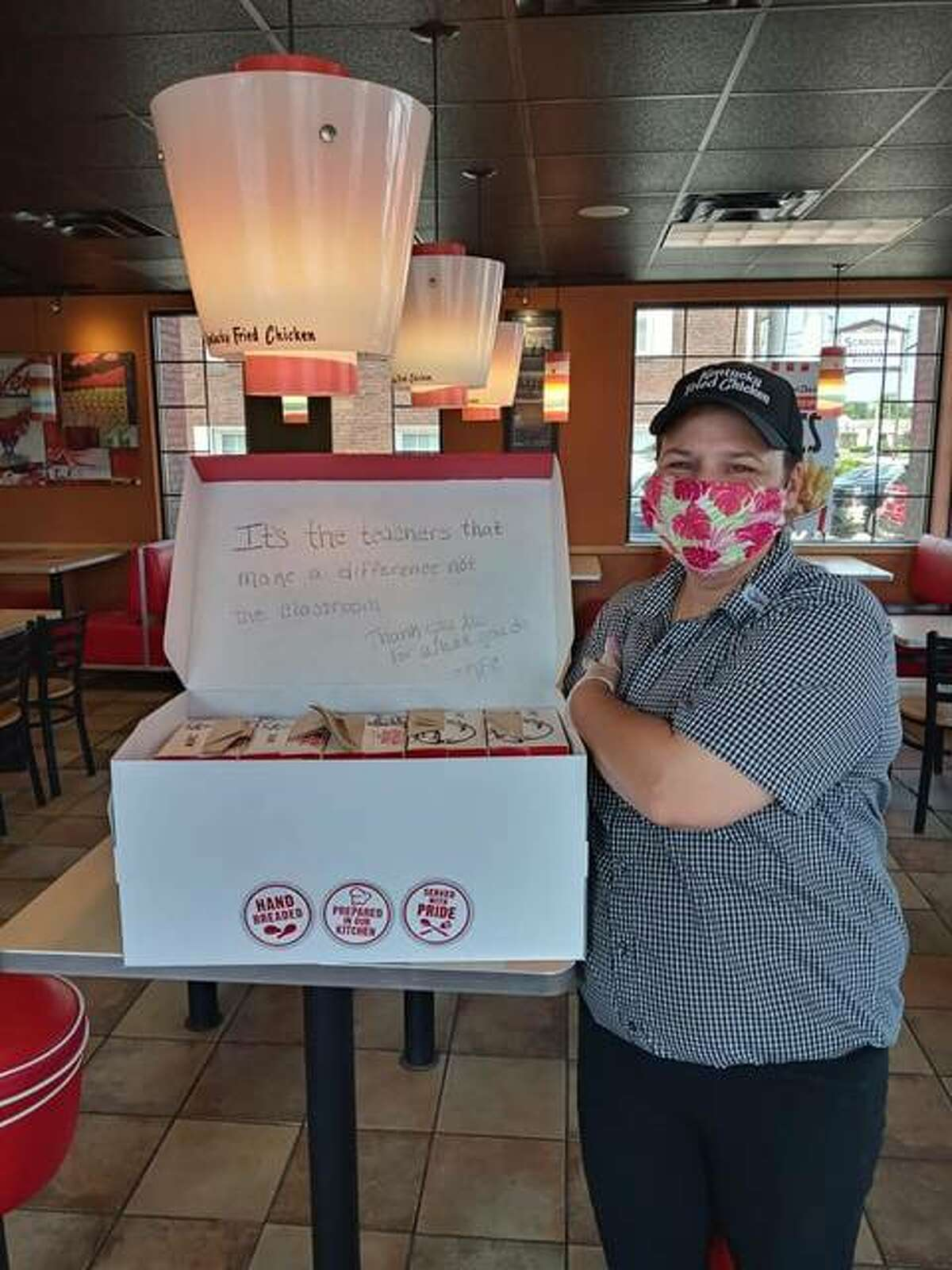 Stephanie Rodgers, general manager of the KFC in Granite City, prepares a delivery box of fried chicken for teachers in Granite City and Belleville. Each box lunch contained a thank you message form the KFC team.