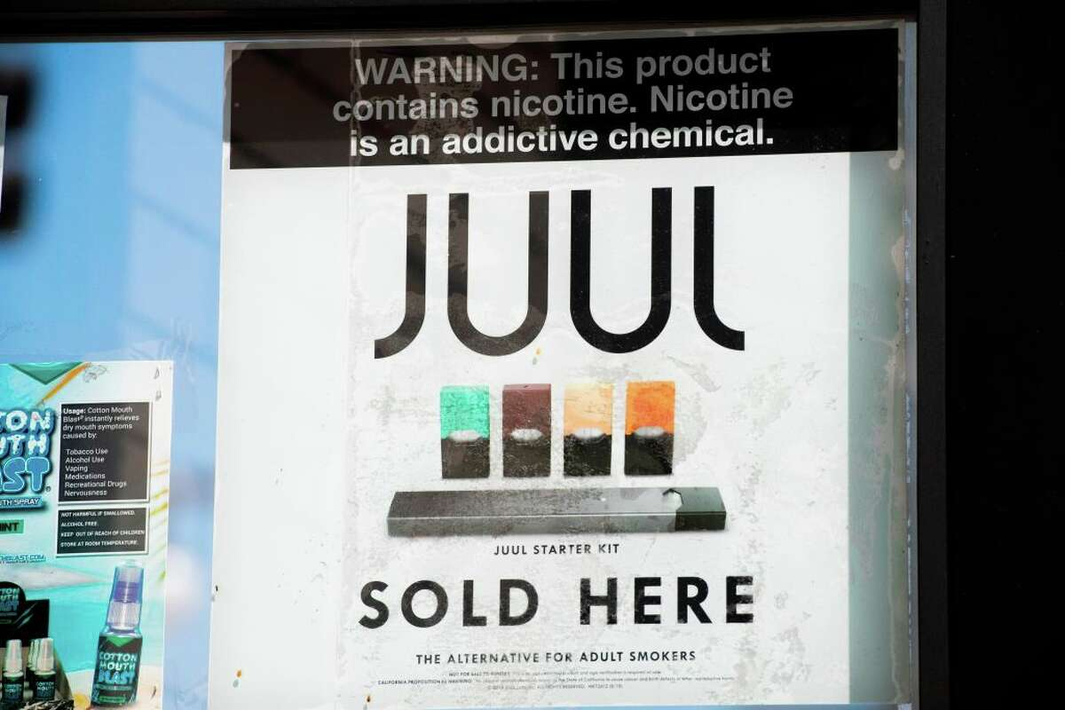 A sign advertises Juul vaping products in Los Angeles, California, September 17, 2019. - New York became the second US state to ban flavored e-cigarettes September 17, following several deaths linked to vaping that have raised fears about a product long promoted as less harmful than smoking. (Photo by Robyn Beck / AFP via Getty Images)