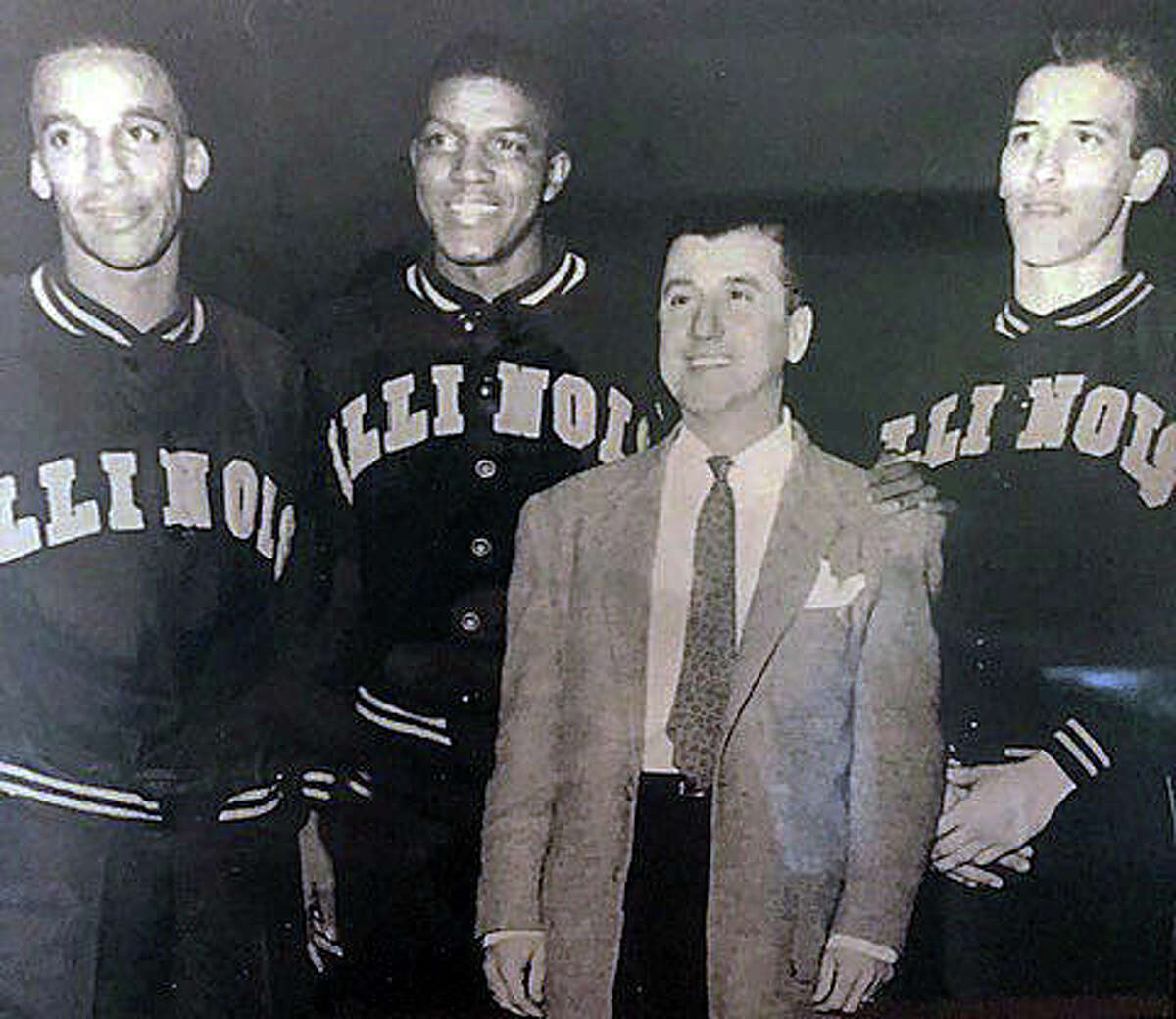Edwardsville graduate Don Ohl, right, with EHS coach Joe Lucco, second from right, and former EHS teammates Mannie Jackson, left, and Govoner Vaughn during their playing days with the Illini.