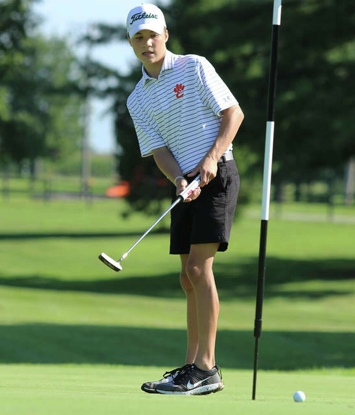 Edwardsville freshman Carter Crow, shown watching his putt stay wide left of the cup during the Hickory Stick Invite on Aug. 17 at Belk Park in Wood River, was at Stonewolf on Tuesday and shot 86 in the Southwestern Conference Tournament in Fairview Heights.