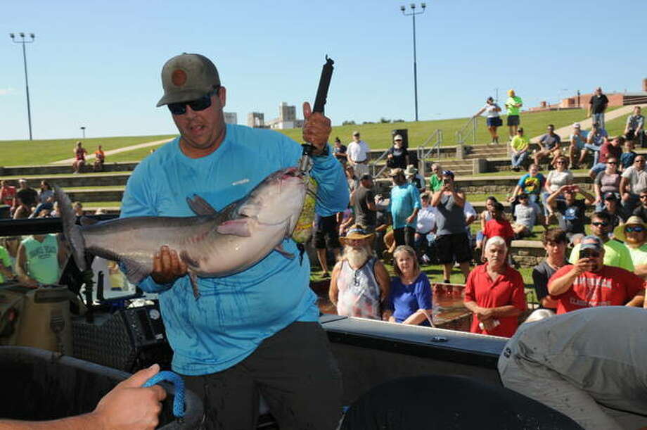 Ryan Casey, of Arnold, Missouri, displays his 40-plus-pound catfish caught Saturday, Sept. 14, 2019, at the inaugural Alton Catfish Classic that drew 200 teams of anglers and large crowds of spectators, helping to fuel a 5.6 percent increase in tourism receipts in Madison County for 2019. The 200-team field of fishermen for this year's tournament planned Sept. 12 was filled in July — but coronavirus concerns forced organizers to cancel the event.
