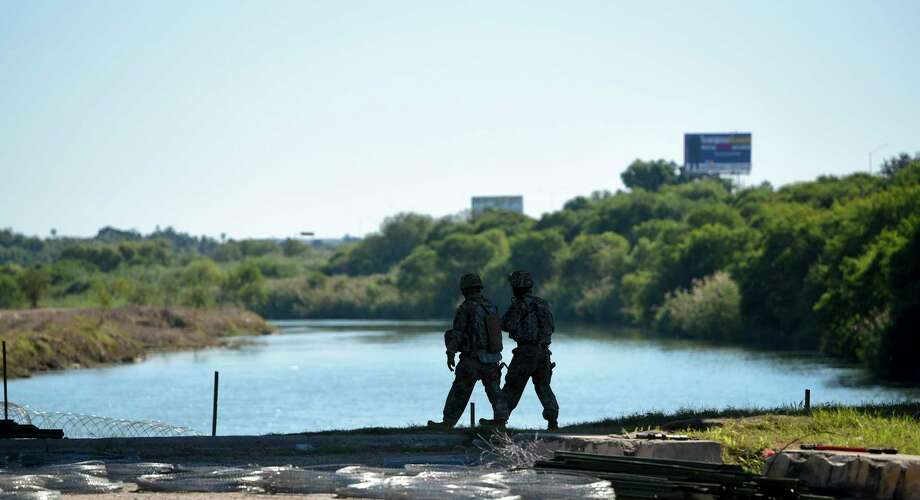 Military members walk along the Rio Grande in this Nov. 16, 2018 photo. Some landowners are speaking out against the wall after Mayor Pete Saenz wrote a letter arguing the city should accept the government's plans. Photo: Danny Zaragoza / Laredo Morning Times / Laredo Morning Times
