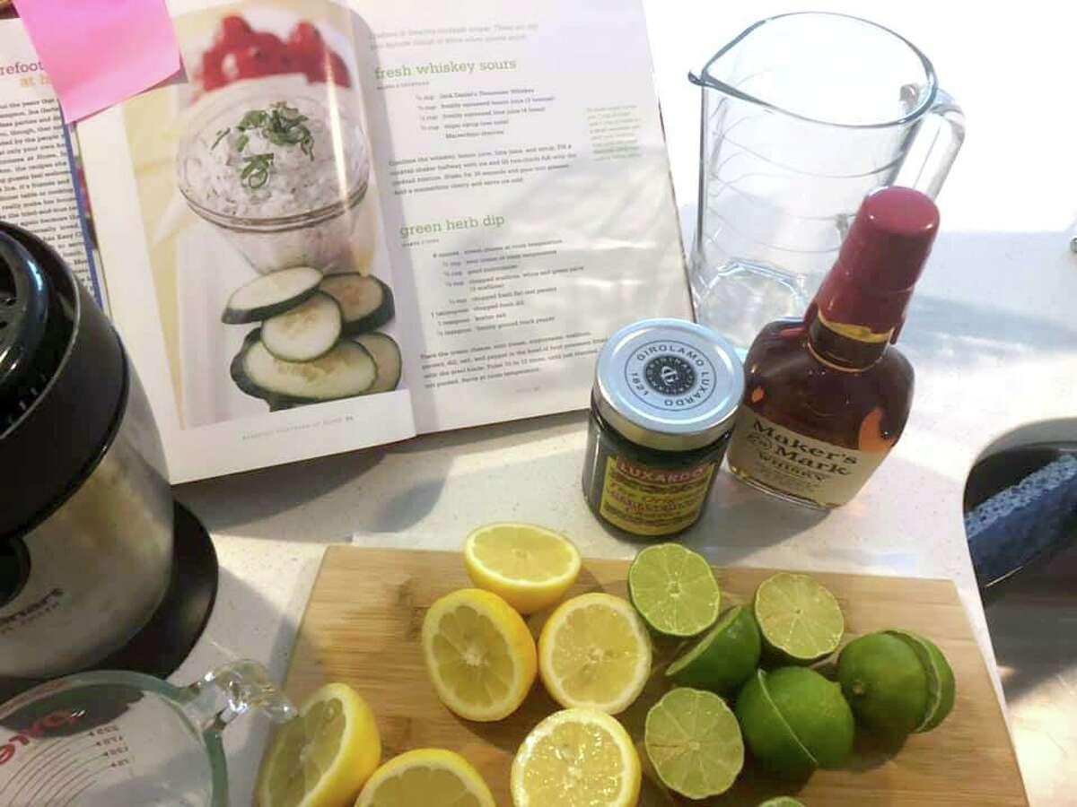 Todd Slack gathers ingredients for Ina Garten's Fresh Whiskey Sour.