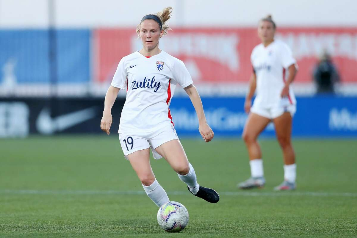 HERRIMAN, UTAH - JULY 18: Kristen McNabb #19 of OL Reign dribbles downfield during the quarterfinal match of the NWSL Challenge Cup at Zions Bank Stadium on July 18, 2020 in Herriman, Utah. (Photo by Maddie Meyer/Getty Images)
