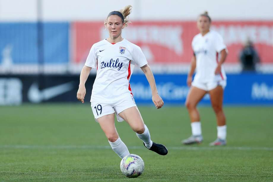 HERRIMAN, UTAH - JULY 18: Kristen McNabb #19 of OL Reign dribbles downfield during the quarterfinal match of the NWSL Challenge Cup at Zions Bank Stadium on July 18, 2020 in Herriman, Utah. (Photo by Maddie Meyer/Getty Images) Photo: Maddie Meyer/Getty Images / 2020 Getty Images