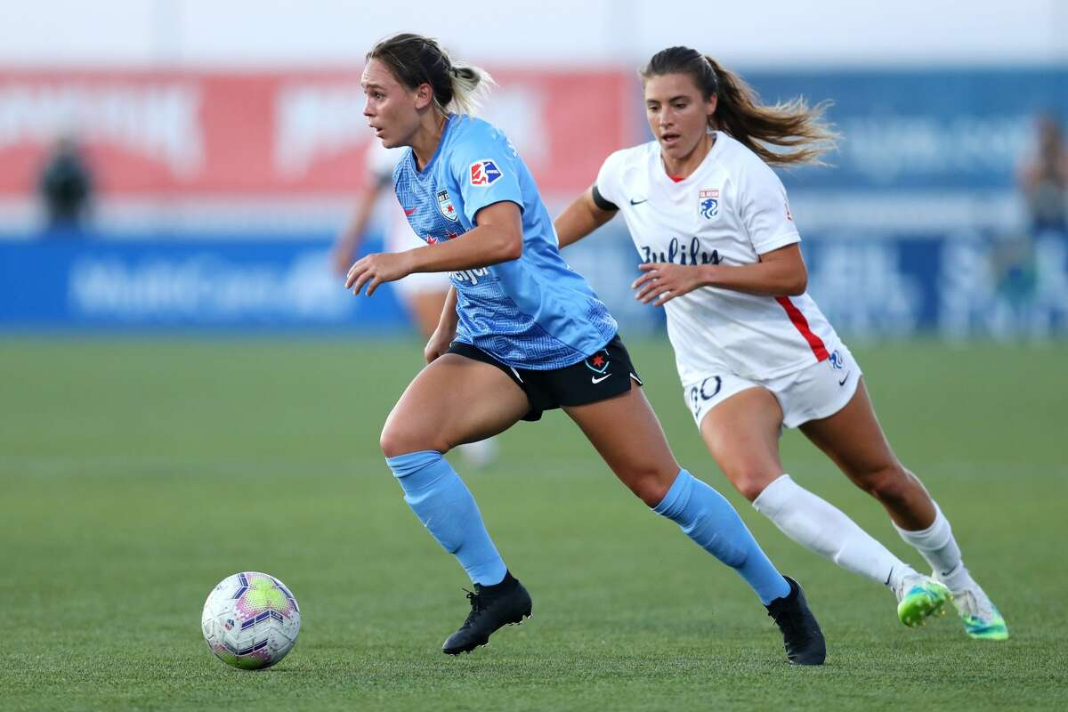 HERRIMAN, UTAH - JULY 18: Sofia Huerta #20 of OL Reign defends Bianca St Georges #29 of Chicago Red Stars during the quarterfinal match of the NWSL Challenge Cup at Zions Bank Stadium on July 18, 2020 in Herriman, Utah. (Photo by Maddie Meyer/Getty Images)
