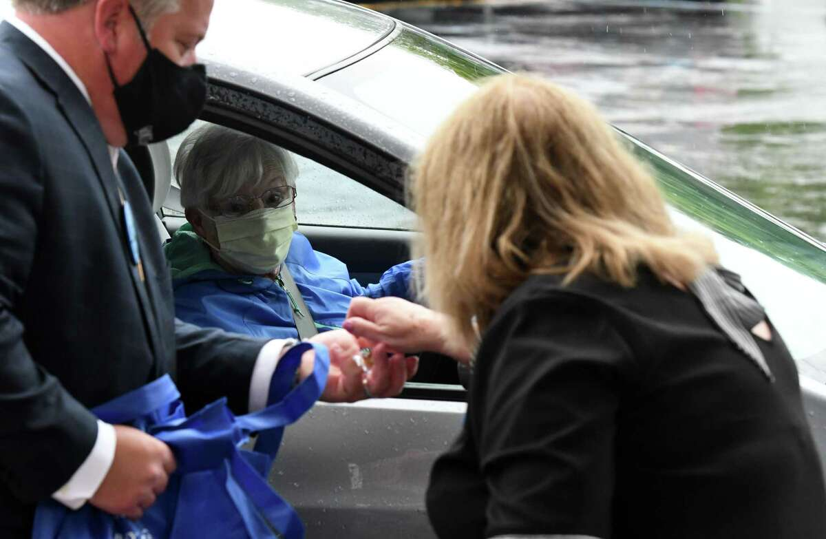 Albany County Executive Dan McCoy, left, and Albany County Department for Aging Commissioner Deb Riitano, right, distribute flu prevention bags to seniors in an effort to stem the spread of flu in Albany County on Wednesday morning, Sept. 2, 2020, at Congregation Beth Emeth in Albany, N.Y. The CDC is warning it could be a severe 2021-2022 flu season because it was low last season due to pandemic protocols, which limited spread. (Will Waldron/Times Union)