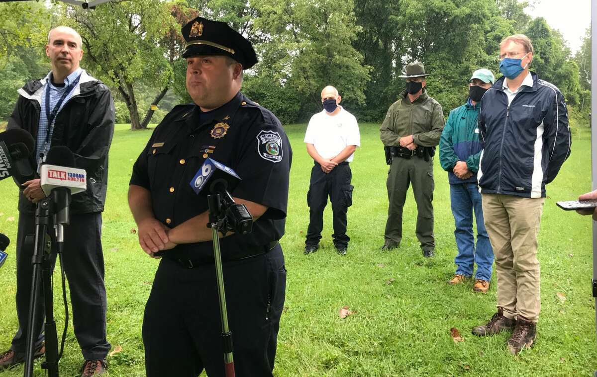 Bethlehem Police Commander Adam  Hornick, foreground, speaks to reporters Wednesday about a chemical leak at SABIC Innovative Chemicals in Selkirk. Scott Danzey, an executive at SABIC, stands to Hornick's left.