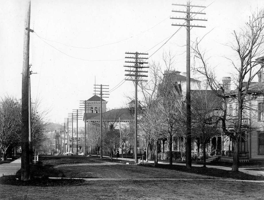 Looking north down Maple Street circa 1890. (Manistee County Historical Museum photo)