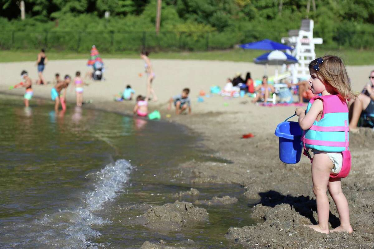 Reagan Ippolito, 2, of Fairfield checks out the water at Lake Mohegan on Sunday, Aug. 30, 2020, in Fairfield, Conn.