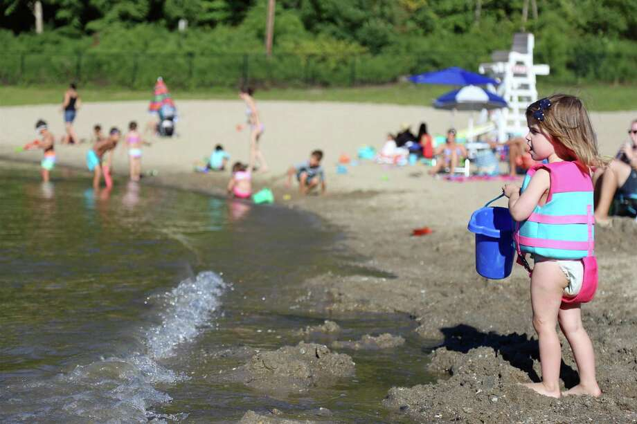 """Reagan Ippolito, 2, of Fairfield checks out the water at Lake Mohegan on Sunday, Aug. 30, 2020, in Fairfield, Conn. No one knows yet who will be taking over the space, but co-owner Patty Kelly-Ruberti of Fairfield and her husband AJ are the new owners of another classic Fairfield spot — Rawley's Drive-In on the Post Road. """"It's been wonderful,"""" Patty said, describing her four-year experience at the lake. """"All the families loved us."""" More than anything, she said, she will miss serving the moms with their kids, for whom she has worked to create healthy options at the stand.  Photo: Jarret Liotta / For Hearst Connecticut Media / Jarret Liotta / ©Jarret Liotta 2020"""