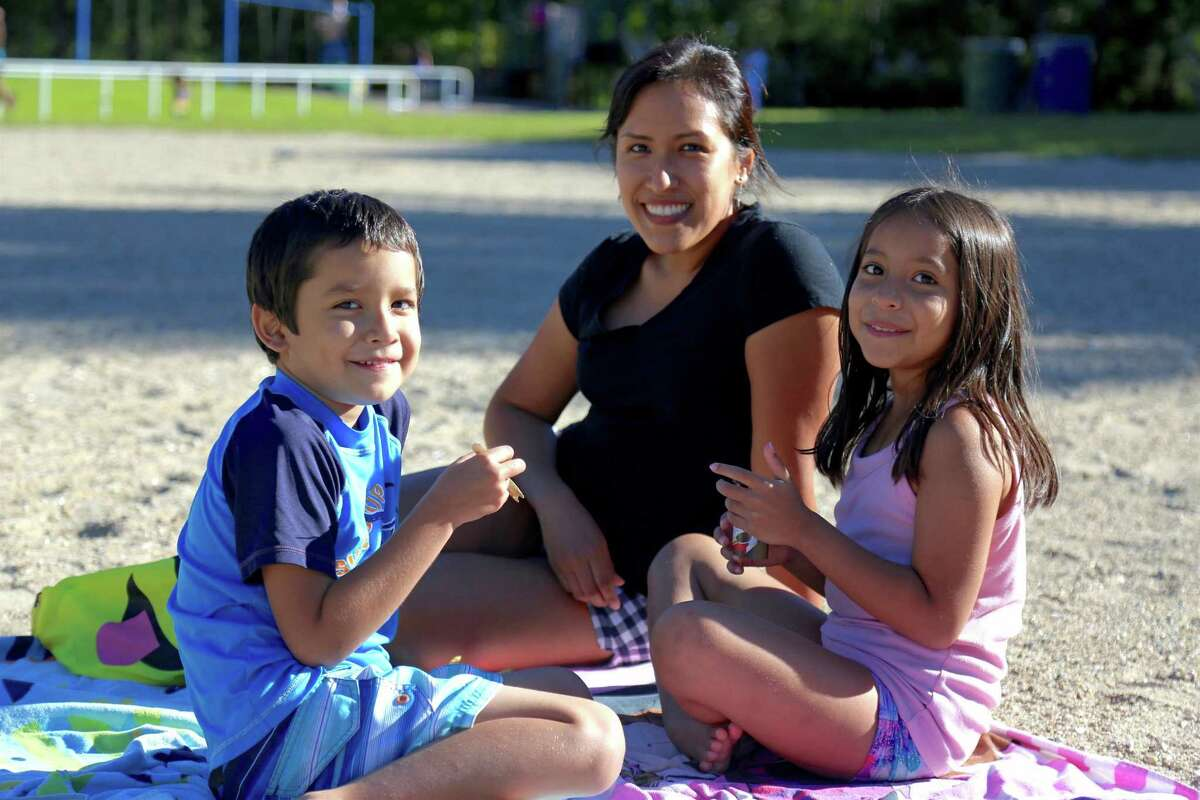 Enjoying a bite are Fabiola Gonzalez of Fairfield and her kids Mario, 6, and Melissa, 8, at Lake Mohegan on Sunday, Aug. 30, 2020, in Fairfield, Conn.