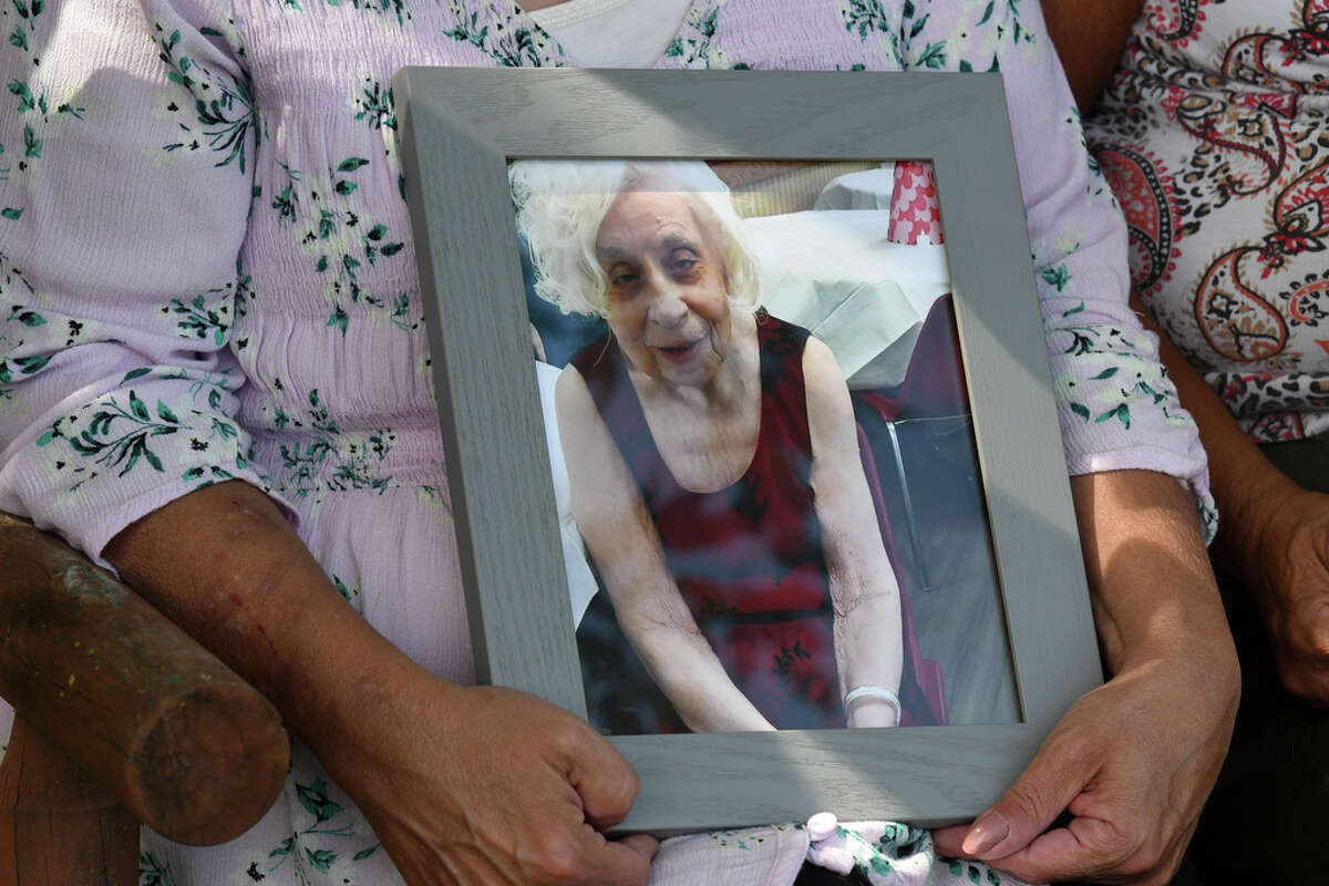 Mary Ann Berghela hold a photo of her late aunt, Rita Drozdzal, on Friday, Aug. 28, 2020, at Mary Ann Berghela's house in Watervliet, N.Y. Rita Drozdzal, 91, died of COVID-19 at Troy Center. The family is calling for a deeper look into the nursing home?•s handling of their aunt?•s case. (Will Waldron/Times Union)