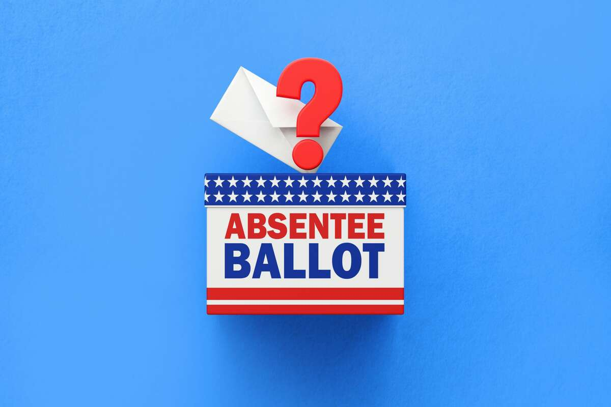 Absentee Ballot written ballot box and white vote envelope sitting on white background. Horizontal composition with copy space. 2020 US Presidential Election concept.