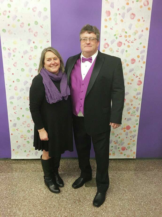 Mark and Karen Sandstedt, owners of MS Creative, at the 2019 Manistee Catholic Central School HARVEST Fling. Mark has served as the master of ceremonies for that fundraiser for a number of years. (Courtesy photo)