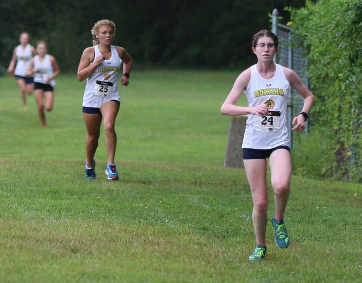 Roxana's Riley Doyle (right) leads teammates (from right) Zoey Losch, Keiko Palen and Gabrielle Woodruff to the finish to give the Shells a sweep of the top four spots in Tuesday's Carlinville Early Meet at Loveless Park.