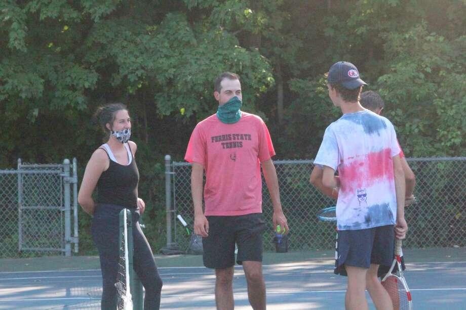 Big Rapids tennis coach Austin Brinker (center) works with his team at a practice last week. (Pioneer photo/John Raffel)