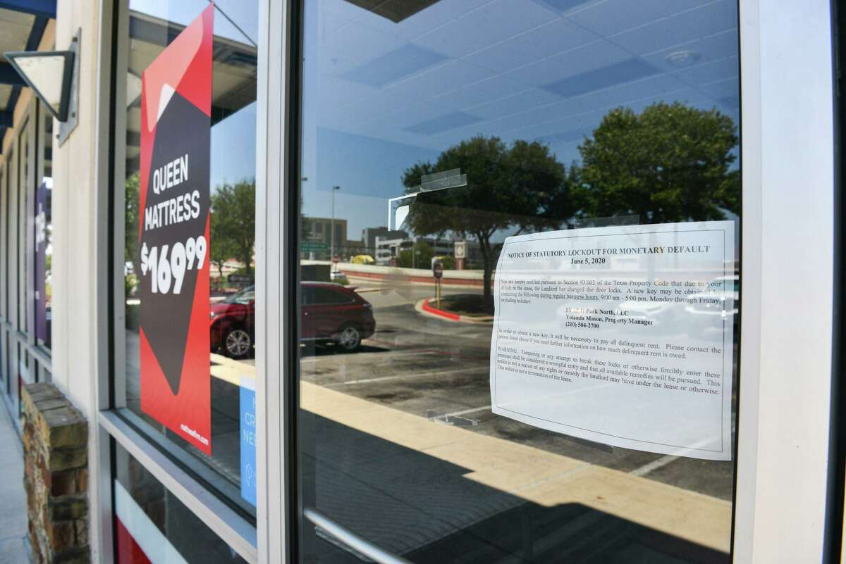 A company affiliated with Sterling Organization, a West Palm Beach, Fla., private equity real estate firm that owns Park North Shopping Center at Northwest Loop 410, sued Mattress Firm for allegedly not paying rent. The sign indicates the landlord changed the locks.