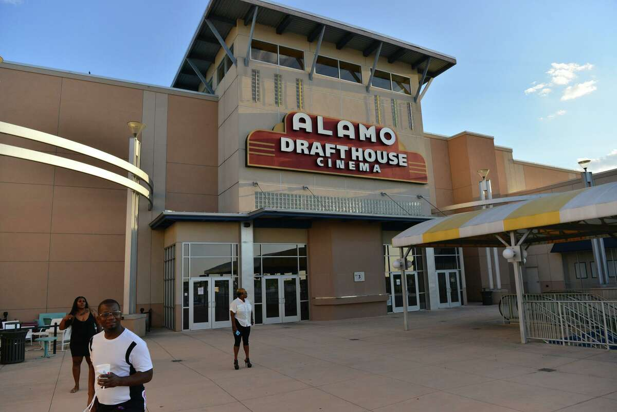 People waiting to enter the Laugh Out Loud Comedy Club stand in front of the closed Alamo Drafthouse last year. Landlord SVAP II Park North LLC had sued Alamo Drafthouse Cinemas in August over unpaid rent.