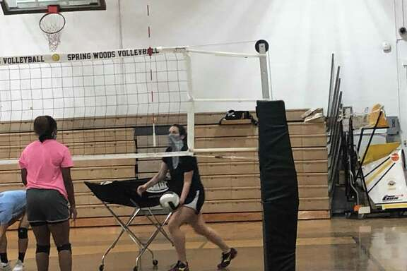 Spring Woods High School volleyball coach Rebecca Campbell helps run drills at practice on Aug. 31
