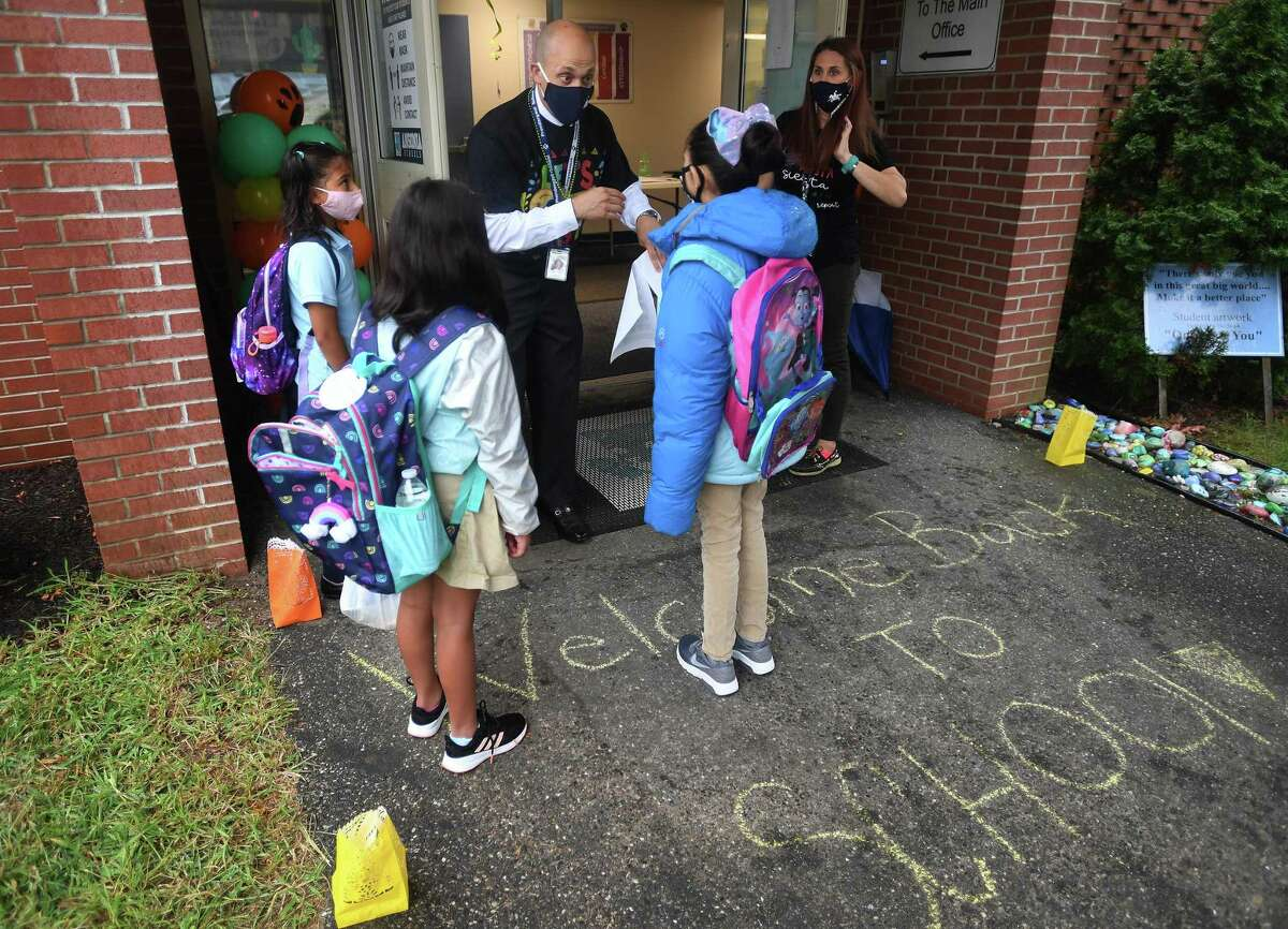 Assistant Principal John Coppola welcomes and guides students on the first day of school at Prendergast School in Ansonia, Conn. on Wednesday, September 2, 2020.
