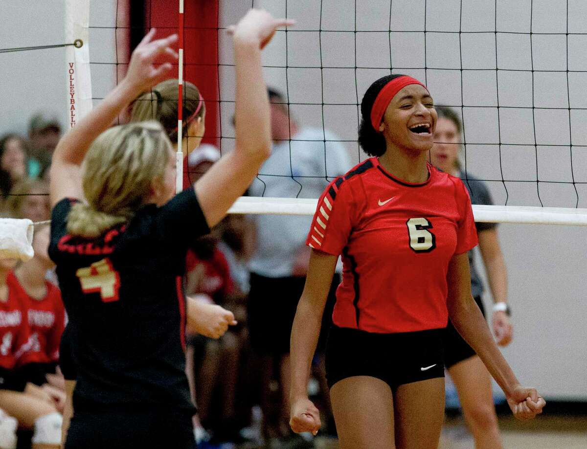 In this file photo, Caney Creek outside hitter Jamiyah Wills (6) reacts after a block in the second set of a match during the Splendora tournament at Splendora High School, Saturday, Aug. 24, 2019, in Splendora.