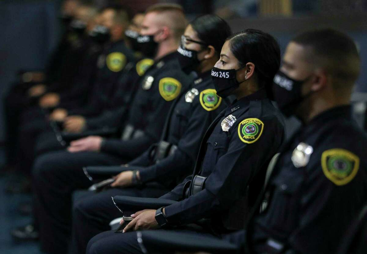 Houston Police cadets listen during the graduation ceremony for HPD cadet class 245 on Monday, Aug. 17, 2020, at the Houston Police Academy L.D. Morrison, Sr. Memorial Center in Houston.