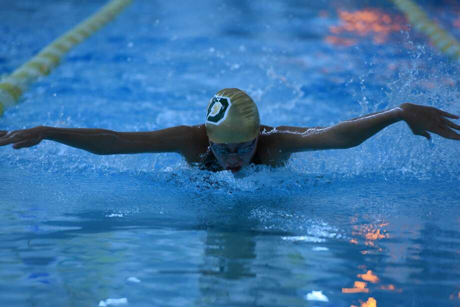 Dow High's Ella Roberson competes in the 100-yard butterfly during the 2019 season. Photo: Daily News File Photo