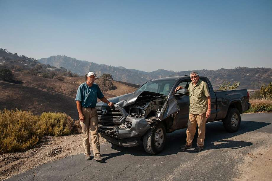 Kurt and Jerome Balasek pose with their car that was damaged by a horse during the LNU Complex Fire, as seen in Vacaville, Calif. on August 27, 2020. Photo: Annika Hammerschlag / Special To The Chronicle